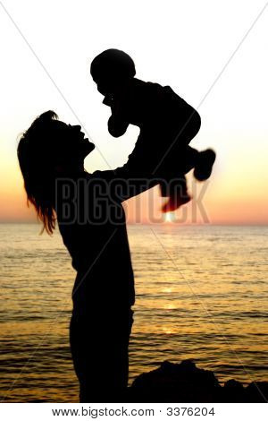 Silhouettes Of Mother And Son Partly Isolated Over White