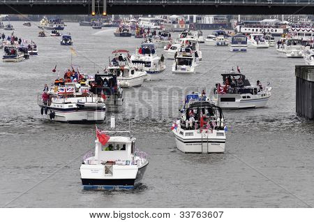 LONDON, UK - JUNE 3: Hundreds of boats muster on the river Thames in Putney for the Thames Diamond Jubilee Pageant to celebrate the Queen's Diamond Jubilee on June 3, 2012 in London.