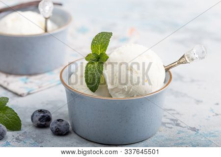 Homemade Vanilla Ice Cream Scoops In Blue Ice-cream Bowl With Berry Spoon In Modern Blue  Interior O