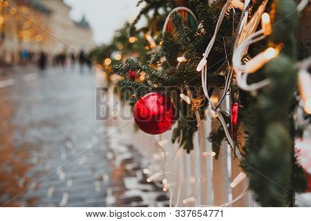 New Year Card, Place For Text, Decoration On A City Street: Red Christmas Ball, Garland And Branches