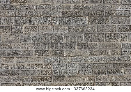 Texture Of The Brickwork In The Wall. Relief And Background Of The Defensive And Enclosing Wall. The