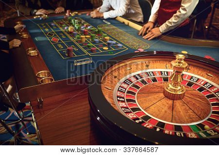 People Gambling At Roulette Poker In A Casino.