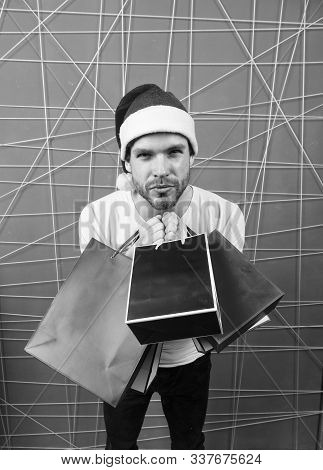 Winter Sale, Shopping Concept. Santa Shopper With Paperbags On Pink Background. Christmas And New Ye