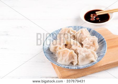 Fresh, Delicious Boiled Pork Gyoza Dumplings, Jiaozi On White Background With Soy Sauce And Chopstic