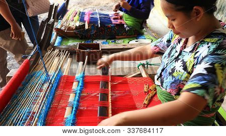Local Residents In Lombok While Knitting Fabrics Using Traditional Looms In Lombok / West Nusa Tengg