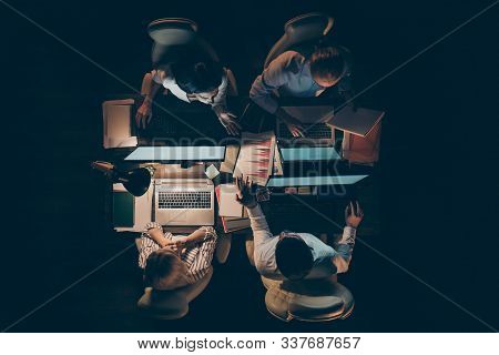 High Angle Above View Photo Of Hard-working Four Busy Business Men Women Working Overtime Looking Co
