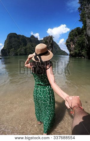 Girls In Green Dress Wearing Hat Holding Hand On A Beautiful James Bond Island, Thailand