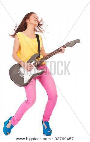 passionate young woman playing the electric guitar on white background poster
