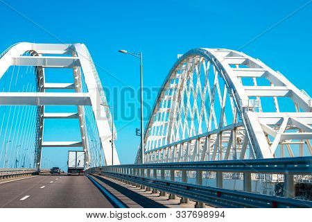 White Arches Of The Crimean Bridge In Russia, Transport Rides, Near The Railway Bridge