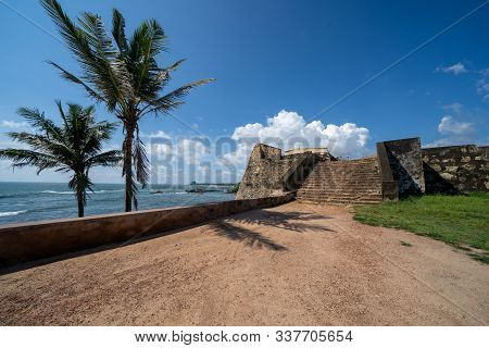 Palm Trees And An Old Staircase Leading Up To Ramparts Of The Dutch Galle Fort In Sri Lanka