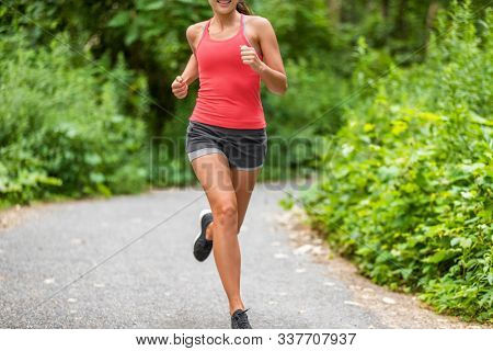 Running woman jogging in park. Healthy active lifestyle.