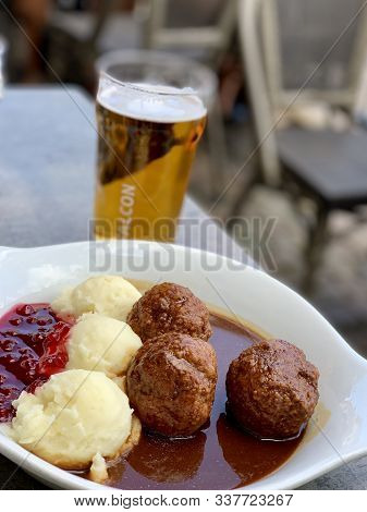 Gothenburg, Sweden - July 27, 2019: Swedish Meatballs. A Plate Of Swedish Meatballs, Gravy, Mashed P