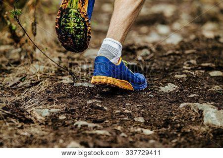 Closeup Legs Running Shoes Athlete Run Uphill On Muddy Trail