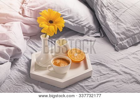 Tray With Coffee, Milk, Orange And Yellow Flower In A Vase.