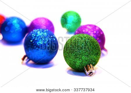 Christmas Tree Ornaments. Isolated on white. Room for text. Christmas Ornaments are enjoyed world wide during the Christmas Holiday Season. Merry Christmas and Happy New Year.