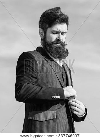 Flawless Outfit. Businessman Bearded Face Sky Background. Man Formal Suit Adjusting Jacket. Male Fas