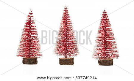 Three Christmas Trees On A White Background. Symbols Of Christmas And New Year
