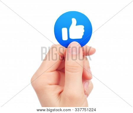 Kiev, Ukraine - May 15, 2019: Hand Holds New Facebook Like Empathetic Emoji Reaction, Printed On Pap