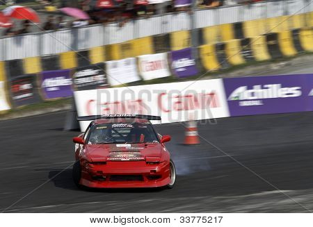 KUALA LUMPUR - MAY 19: Indonesia's Rhenadi Arinton in a Nissan Silvia 180SX accelerates and drifts on the tarmac during the Formula Drift 2012 Asia Round 1 on May 19, 2012 in Speedcity, Malaysia.