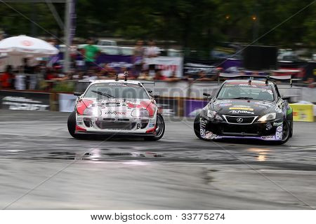 KUALA LUMPUR - MAY 20: Daigo Saito (black Lexus) chases Max Orido (red/white RSR) during the Formula Drift 2012 Asia Round 1 on May 20, 2012 in Speedcity, Malaysia. Daito Saito emerged the champion.