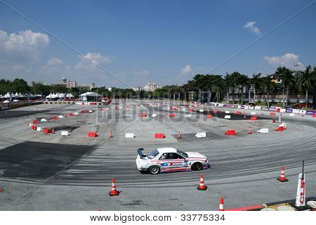 KUALA LUMPUR - MAY 19: Malaysia's Ee Yoong Chern drives around the Speedcity Circuit during a practice run at the Formula Drift 2012 Asia Round 1 on May 19, 2012 in Speedcity, Kuala Lumpur, Malaysia.