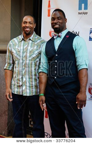 NEW YORK-MAY 31: New York Giants Michael Boley (L) and Justin Tuck attend the 4th annual Tuck�s Celebrity Billiards Tournament on May 31, 2012 in New York City.
