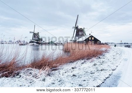 Windmills On The Zaans Schans In Winter Located On The River De Zaan In The Netherlands