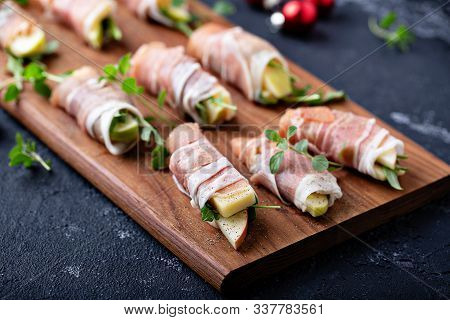 Christmas Or New Year Party Appetizer, Prosciutto Wrapped Apples And Cheese