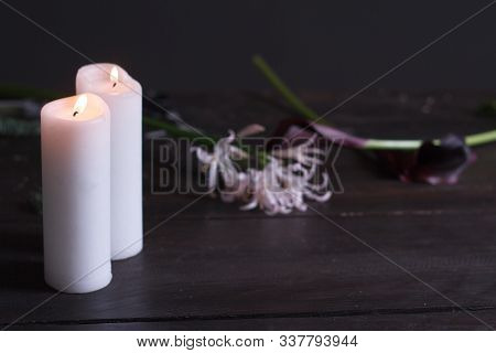 Close-up Of Two Large White Candles Burning On A Dark Background, Selective Focus