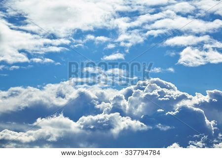 Blue Sky With A Big White Cloud In The Light Of The Sun. Large Fluffy Cumulonimbus Clouds. Meteorolo