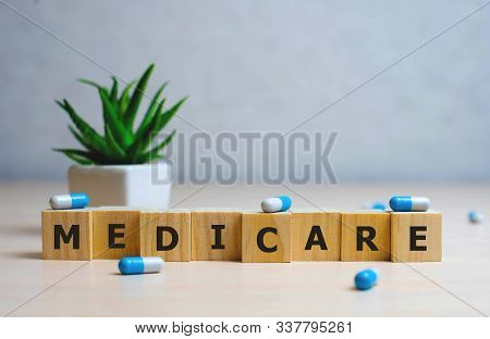 Medicare Word Made With Building Blocks, Medical Concept Background