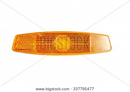 Bicycle Wheel Reflector Isolated On White Background. Orange Plastic Reflector Which Is Mounted On A