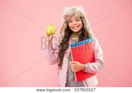 Healthy Snack. Modern Education. Stylish Schoolgirl. Girl Little Smiling Schoolgirl Hold Apple Fruit