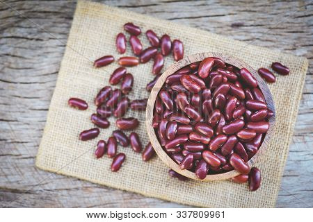 Red Bean In Wooden Bowl On Sack Background / Grains Red Kidney Beans , Top View