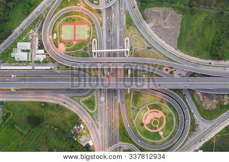 Aerial View Of Highway Junctions Top View Of Urban City, Bangkok At Evening, Thailand. Car And Truck