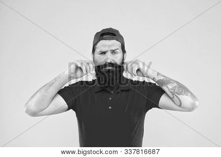 Cool And Stylish. Man Bearded Hipster Twisting Mustache Yellow Background. Barber Salon. Moustache G