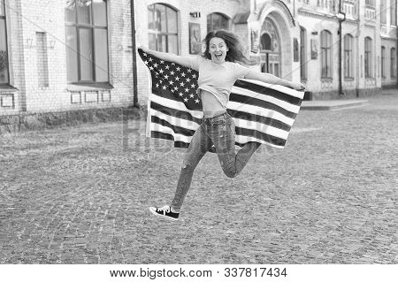Being Free And Live Life Fully. Happy Girl Jumping Free With American Flag Outdoor. Sensual Woman Ce