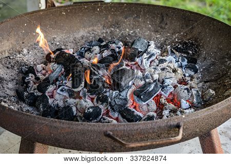 Bbq Grill Pit Glowing And Flaming Hot Charcoal Briquettes Coal Food Background Or Texture Close-up T