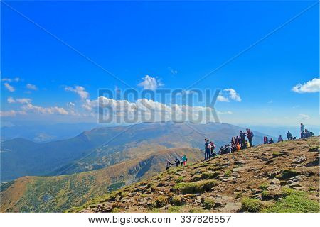 Top Of The Mountains Goverla, Ukraine - September 20, 2018. The Picture Shows A Group Of Tourists On