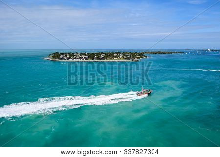 Key West, Florida/usa - November 12, 2019:  A U.s. Coast Guard Vessel Patrols The Ocean, Near Sunset