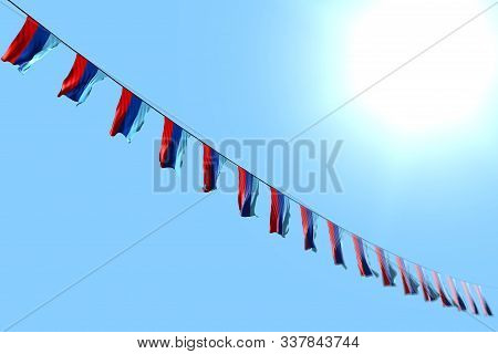 Wonderful Many Luhansk Peoples Republic Flags Or Banners Hanging Diagonal On Rope On Blue Sky Backgr