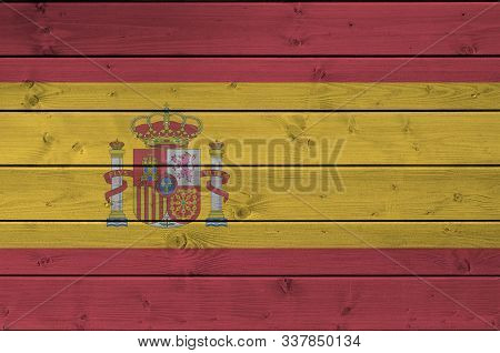 Spain Flag Depicted In Bright Paint Colors On Old Wooden Wall. Textured Banner On Rough Background