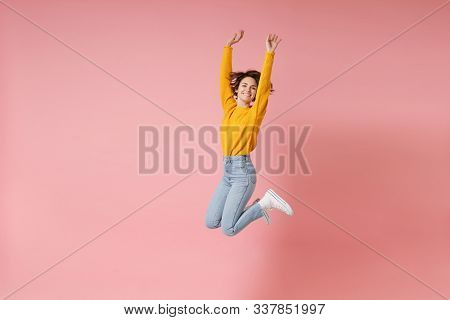 Cheerful Young Brunette Woman Girl In Yellow Sweater Posing Isolated On Pastel Pink Background In St