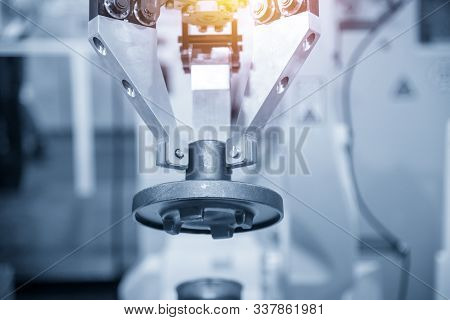 The  Robotic Arm Handle The Metal Casting Parts For Safety Reason In Modern Technology Factory. The