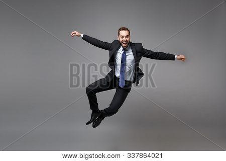 Cheerful Young Business Man In Classic Black Suit Shirt Tie Posing Isolated On Grey Background. Achi