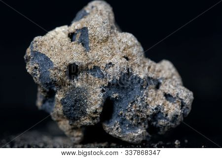 Calcium Carbide Or Calcium Acetylide With A Black Background