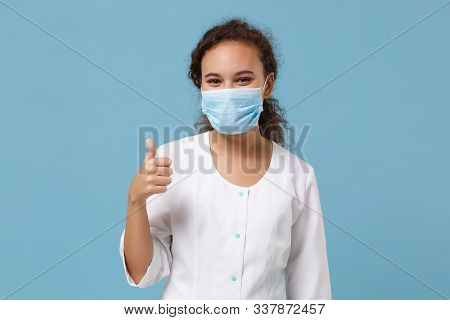African American Doctor Woman Isolated On Blue Background. Female Doctor In White Medical Gown, Ster