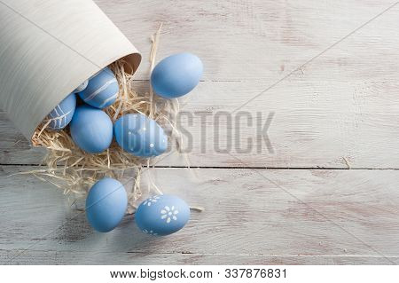 Easter Painted Eggs On Wooden Background
