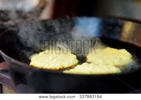 Delicious Potato Pancakes Being Fried On Traditional Spring Market In Vilnius, Lithuania. Variety Ta