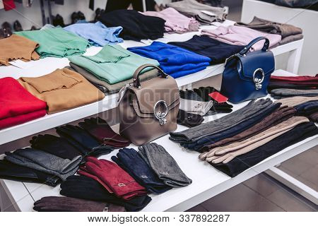 Showcase In Women's Clothing Store With Warm Sweaters And Winter Accessories. Luxury En Gloves In Di
